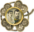Jewelry, Nicholas and Alexandra Silvered Metal Quatrefoil Brooch . Circa 1896. Inset with the portraits of the Imperial couple-...