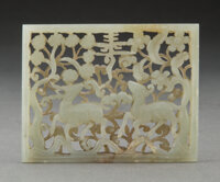 A Chinese Celadon Jade Deer Plaque, Ming Dynasty 2-1/4 x 3 x 0-1/4 inches (5.7 x 7.6 x 0.6 cm)