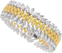 An Attractive yellow and white diamond bracelet mounted in 18k white and yellow gold  The multi-row highly satu