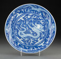 Ceramics & Porcelain, A Chinese Blue and White Dragon Plate. Marks: six-character Daoguang mark and of period. 1-3/4 x 10 inches (4.4 x 25.4 cm). ...