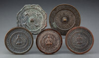A Group of Five Chinese Bronze Mirrors 0-1/2 x 4-1/4 inches (1.3 x 10.8 cm) (largest)