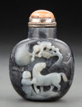 Carvings, A Chinese Carved Black and White Jade Snuff Bottle. 3-1/4 x 2-1/4 x 1-5/8 inches (8.3 x 5.7 x 4.3 cm). ...