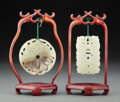 Carvings, Two Chinese Carved Jade Plaques in Wood Hanging Armatures. 2-3/4 inches (7.0 cm) (largest, circular plaque). ... (Total: 2 Items)