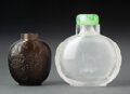 Carvings, Two Chinese Carved Rock Crystal Snuff Bottles. 2-3/8 x 2-3/4 inches (6.2 x 7.0 cm) (tallest). ... (Total: 2 Items)