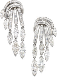 Pair of platinum and diamond waterfall earclips, Circa 1955  Designed as a cascade of baguette diamonds flowing
