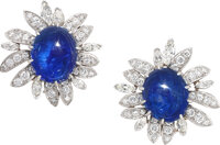 Pair of platinum, cabochon sapphire and diamond flower earclips  Designed as blooming flowers, each ear clip ce