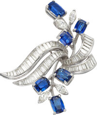 A platinum, sapphire and diamond foliate spray brooch  This mid-century brooch is designed as a sapphire and ma
