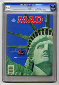 "Magazines:Humor, Mad #252 Gaines File pedigree (EC, 1985) CGC NM 9.4 White pages.Cover by Doug Webb (as ""Armanli""). Artists include Mort Dru..."