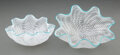 Glass, Dale Chihuly (American, b. 1941). White Seaform Pair with Teal Lip Wraps, 2012. Glass. 4-1/4 x 9-1/2 x 7-1/2 inches (10.... (Total: 2 Items)