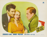 """This Gun for Hire (Paramount, 1942). Lobby Card (11"""" X 14""""). Alan Ladd, as the cruel protagonist, received fou..."""