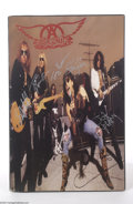 Music Memorabilia:Autographs and Signed Items, Aerosmith Group Signed Poster....