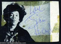 Jimi Hendrix Signed Photograph Clipping. 4 x 3 black and white photograph, removed from a concert program, featuring the...