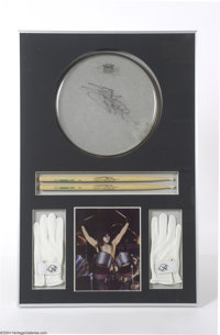 KISS: Eric Carr Used Drumhead, Sticks and Gloves. Impressive display featuring an assortment of concert used relics from...