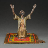 An Austrian Cold Painted Bronze Robed Figure on Prayer Rug, circa 1890 Marks: AUSTRIA 6-1/2 x 7 x 9-1/2 inches