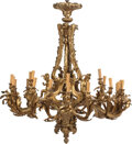 Lighting, A French Rococo-Style Gilt Bronze Twenty-Four-Light Chandelier in the Manner of Jean-Jacques Caffieri. 50 x 48 inches (127 x...