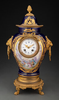 A French Sevres-Style Gilt Bronze-Mounted Porcelain Covered Urn with Clock, late 19th century Marks: (Double-Louis