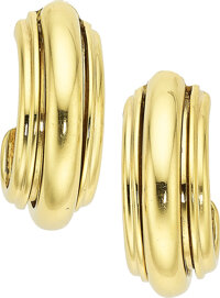 A pair of 18k yellow gold earclips, Piaget  Of classical fluted gold design, these earrrings can be worn day or