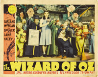 """The Wizard of Oz (MGM, 1939). Lobby Card (11"""" X 14""""). This wonderful scene from Munchkin Land depicts Judy Gar..."""