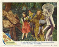 "Movie Posters:Musical, The Wizard of Oz (MGM, R-1949). Lobby Card (11"" X 14""). In thisscene card, Bert Lahr holds a Flit gun marked ""Witch Remover..."