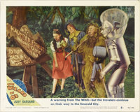 """The Wizard of Oz (MGM, R-1949). Lobby Card (11"""" X 14""""). In this scene card, Bert Lahr holds a Flit gun marked..."""