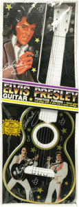 Music Memorabilia:Memorabilia, Elvis Presley Toy Guitar, Still Sealed. A rare vintage toy guitardecorated with images of Elvis circa the early to mid-'70s...