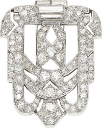 An Art Deco diamond clip, French, Circa 1930  The normally strong geometric design beautifully softened by diam