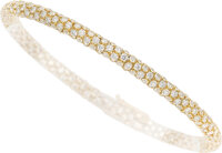 A very fine and chic 18K yellow gold and diamond bracelet  Very flexible and tactile, this bracelet is paved wi