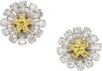 A pair of colorful diamond flower earrings, Circa 1960  Each designed as a diamond set platinum blooming flower