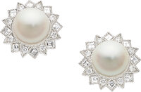 A pair of cultured pearl and diamond starbust earrings  Centering on a cultured pearl within a border of altern
