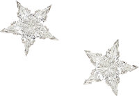 An exquisite pair of platinum and diamond star earrings  Designed as a shining star, these beautifully made ear