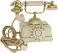 "Movie/TV Memorabilia:Props, Prop Telephone from ""Tony Rome."" An ivory-and gold toneFrench-style telephone used as a prop in Tony Rome (1967),the f..."