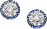 A very fine pair of sapphire and diamond earrings  Each centering on a collet set circular diamond cluster with