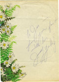 "Movie/TV Memorabilia:Autographs and Signed Items, Judy Garland Autograph. A sheet of 8"" x 11"" stationery with acolorful floral pattern along the left, inscribed ""To Joe - fr..."