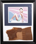 "Movie/TV Memorabilia:Memorabilia, Framed Display of ""Pin Up Girl"" Betty Grable's Nylon Stockings.During the Word War II years, Betty Grable (1916-1973) was t..."