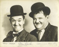 "Movie/TV Memorabilia:Autographs and Signed Items, Stan Laurel and Oliver Hardy Signed Photo. A b&w 10' x 8"" promophoto of the legendary comedy team, signed by both in black ..."