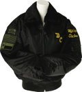 "Music Memorabilia:Costumes, Dixie Chicks Tour Jacket. Black bomber-style tour jacket with orange lining, the letters ""DC"" embroidered on the left breast..."