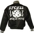 "Music Memorabilia:Costumes, Rolling Stones World Tour Jacket. A black satin jacket withblack-and-white trim and a large ""Stones 1972 World Tour"" logo o..."