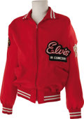 "Music Memorabilia:Costumes, Ed Parker's ""Elvis In Concert"" Tour Jacket. A red nylon jacket with an ""Elvis in Concert"" patch sewn over the left breast an..."