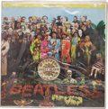 """Music Memorabilia:Recordings, Beatles LP Group of 2 (Canada - 1967 and 1969). Sealed copy of """"Sgt. Pepper's Lonely Hearts Club Band"""" (Capitol 2653, 1967) ... (Total: 2 )"""