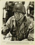 """Movie/TV Memorabilia:Autographs and Signed Items, Lee Marvin Signed Photo. A b&w 8"""" x 10"""" promo photo for the1980 war movie The Big Red One signed by Marvin in blackmar..."""
