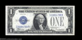 Small Size:Silver Certificates, Fr. 1605 $1 1928E Silver Certificate. About Uncirculated.