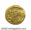 Ancients:Byzantine, Ancients: Justin II. A.D. 565-578. AV solidus (20 mm, 4.39 g).Constantinople. Diademed, helmeted and cuirassed bust facing,holding V...