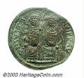 Ancients:Byzantine, Ancients: Justin II. A.D. 565-578. AE follis (31 mm). Nicomedia,year 4 (A.D. 568/9). Justin, on left, holding globus cruciger inleft...