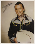 "Movie/TV Memorabilia:Autographs and Signed Items, Roy Rogers Signed Photo. A color 8"" x 10"" glossy of the King of theCowboys, signed by him in black ink. In Excellent condit..."
