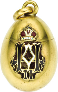 Gold and Enamel Egg Pendant 20th century  Of polished gold, decorated with enameled black and white enameled initial