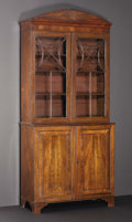 Furniture , An Eighteenth Century American Two-Door Arch-Top Bookcase. Unknown maker, American. Eighteenth Century. Mahogany, glass. U...