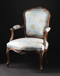 A French Louis XV Style Carved Wood Fauteuil  Unknown maker, French Nineteenth century Carved walnut, upholstery Unmark...