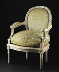Furniture: French, A Louis XVI Style Armchair. Unknown maker, France. NineteenthCentury. Painted wood. Unmarked. 33 inches high. With oval b...