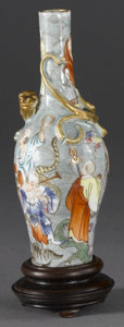 Asian:Chinese, CHINESE CARVED VASE. Chinese carved ceramic vase, with paintedscenes of men and animals in a landscape, and with a figure...