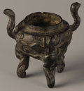 Asian:Chinese, BRONZE CENSER. Bronze censer, with foliate designs and doublehandles. Seal to base. 3.5in. high. ...